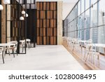 Stock photo dark wooden panoramic cafe interior in a skyscraper with a wooden floor round tables and chairs 1028008495