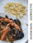 Small photo of seafood sauce pasta or pasta allo scoglio