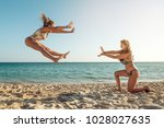 two girls playing and having... | Shutterstock . vector #1028027635