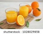glasses with fresh orange juice ... | Shutterstock . vector #1028029858