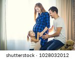 a family of three. pregnant mom ... | Shutterstock . vector #1028032012