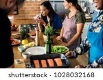 diverse people joining cooking... | Shutterstock . vector #1028032168
