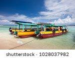 tourist boats near gili meno... | Shutterstock . vector #1028037982
