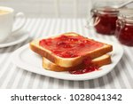 delicious toast with sweet jam...   Shutterstock . vector #1028041342