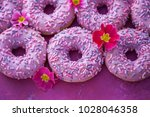 delicious pink donuts on pink... | Shutterstock . vector #1028046358