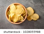 bowl with crispy potato chips... | Shutterstock . vector #1028055988