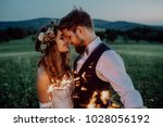 beautiful bride and groom with... | Shutterstock . vector #1028056192