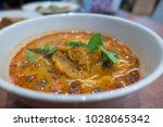 closeup of curry noodles  | Shutterstock . vector #1028065342