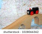 toy locomotive on the bridge on ... | Shutterstock . vector #1028066362