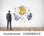 businessman looking at a...   Shutterstock . vector #1028089015