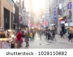 abstract background many people ... | Shutterstock . vector #1028110882