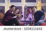 happy group of friends doing...   Shutterstock . vector #1028111632