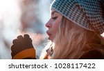 woman breathing on her hands to ... | Shutterstock . vector #1028117422