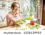 young woman eating healthy food ... | Shutterstock . vector #1028139955