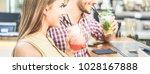 happy trendy couple drinking... | Shutterstock . vector #1028167888