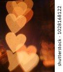 glowing golden blurred... | Shutterstock . vector #1028168122
