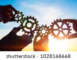 four hands of businessmen... | Shutterstock . vector #1028168668