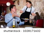 dissatisfied male expressing... | Shutterstock . vector #1028171632