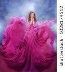 beautiful woman in pink dress | Shutterstock . vector #1028174512
