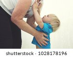 crying baby boy in blue t shirt ... | Shutterstock . vector #1028178196