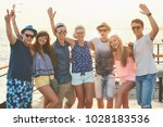 group of happy carefree friends ... | Shutterstock . vector #1028183536