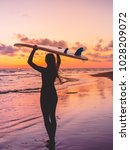 surf woman go to surfing. girl... | Shutterstock . vector #1028209072