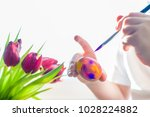 child's hands with a brush...   Shutterstock . vector #1028224882
