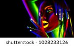 disco dancer in neon light.... | Shutterstock . vector #1028233126