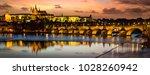 prague castle after sunset.... | Shutterstock . vector #1028260942