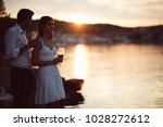 two young people enjoying a... | Shutterstock . vector #1028272612