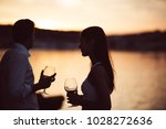 two young people enjoying a... | Shutterstock . vector #1028272636