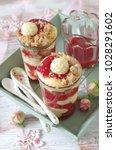 Small photo of strawberry vanilla cream trifle with hazelnut crumbles