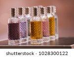 perfume bottles in a store in...   Shutterstock . vector #1028300122