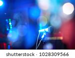 closeup of a microphone for... | Shutterstock . vector #1028309566