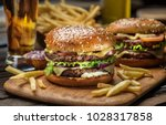 hamburgers and french fries on... | Shutterstock . vector #1028317858