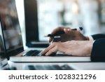 businessman using computer to...   Shutterstock . vector #1028321296