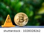 golden bitcoin and warning sign ... | Shutterstock . vector #1028328262