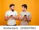 portrait of a two shocked young ... | Shutterstock . vector #1028337862