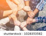 business team to cooperate in... | Shutterstock . vector #1028353582