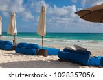 luxury blue beach chairs on the ... | Shutterstock . vector #1028357056