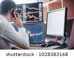 stockbroker in shirt is working ... | Shutterstock . vector #1028383168