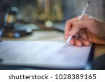 lawyer sitting working at the... | Shutterstock . vector #1028389165