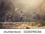asian children play soccer in... | Shutterstock . vector #1028398186