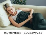 womsn stomach pain. female... | Shutterstock . vector #1028399266