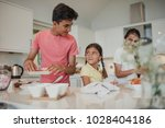 siblings preparing food in the... | Shutterstock . vector #1028404186
