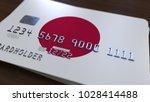 plastic bank card featuring... | Shutterstock . vector #1028414488
