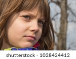 a beautiful girl poses in...   Shutterstock . vector #1028424412