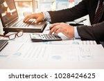 a businessman analyzing... | Shutterstock . vector #1028424625