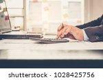 a businessman analyzing...   Shutterstock . vector #1028425756