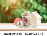 view of coin stack with house... | Shutterstock . vector #1028425945